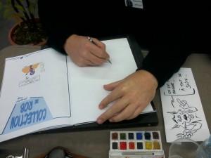 Chacal au travail, avec le dessin d'absence offert à Géraldine en fin de festival.